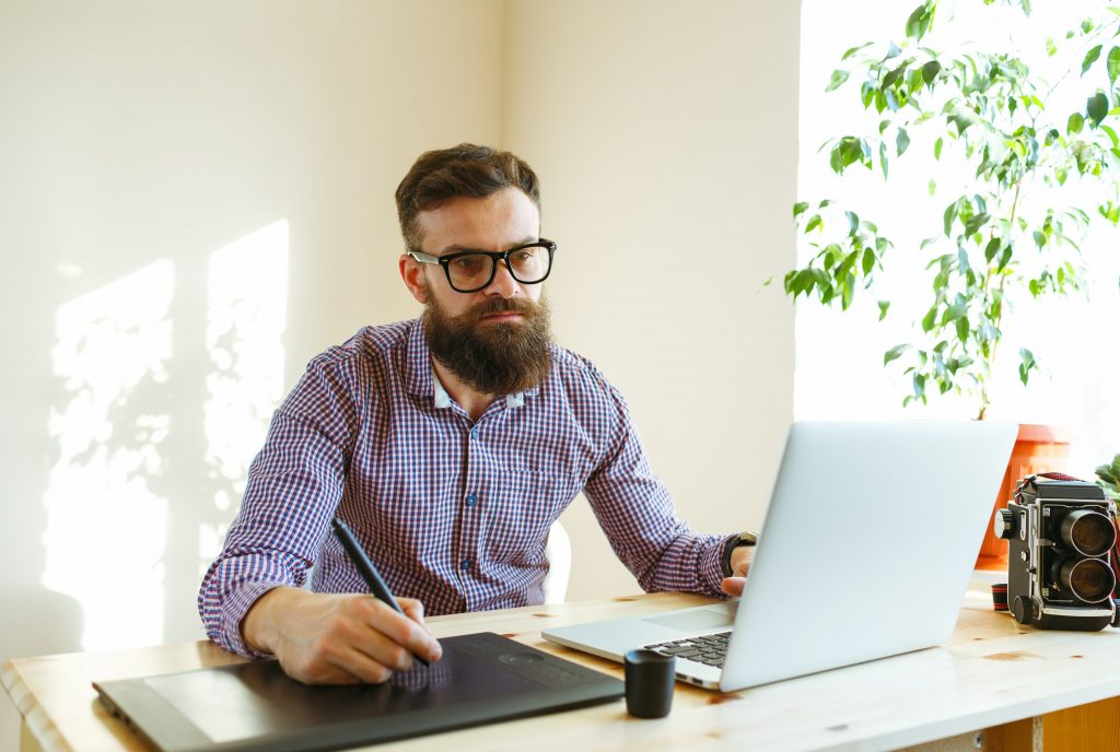 beard-young-man-working-from-home-P85T5LV-2